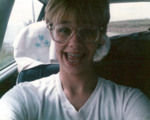 Photo I took of myself (yes, I was taking selfies looooong before it was a thing) on the drive to cheerleading camp.